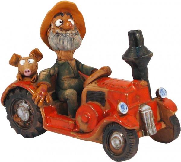 Bauer im Traktor