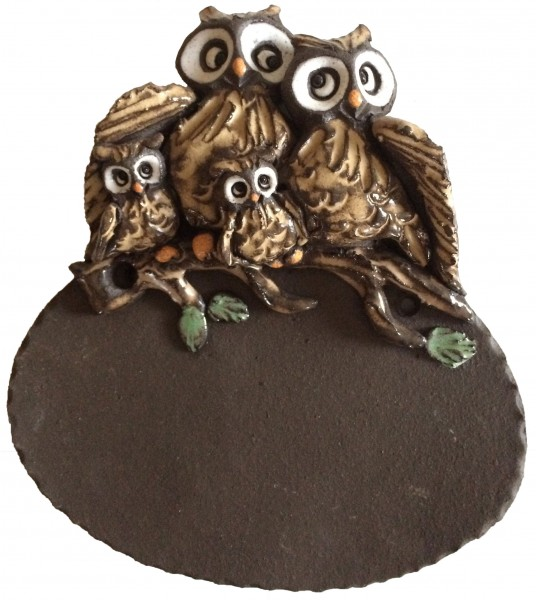 Owl duo with two children